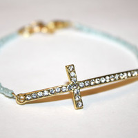 Gold Cross Pearlized Sea blue/green glass beaded bracelet