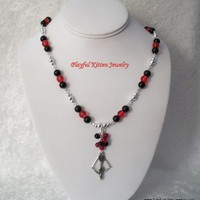 Fire and Night Katniss Bow Necklace