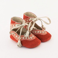 Coral pink leather baby shoes with beige leather stitch embellishment