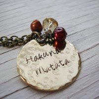 Hakuna Matata hand stamped brass necklace with freshwater pearls and yellow czech crystal