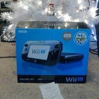Nintendo Wii U Deluxe Set 32 GB Black Console in hand NEW w Nintendo Land