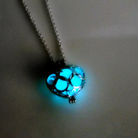 Glow in dark poisoned heart necklace