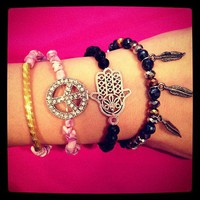 Shells, Peace, Feather, & Hamsa Bracelet from La Fede Boutique
