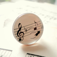 Ring made with vintage sheet music under by ScrapHappyLyrebird
