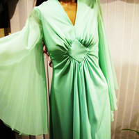 vintage mint green long gown.  sheer batwing sleeves. size S to M.