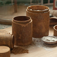 set of three round cinnamon bark boxes by nom living | notonthehighstreet.com