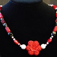 Carved Red Daisy Flower Accented with White, Black, and Red Beads
