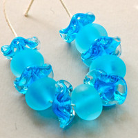 handmade lampwork glass beads seaglass set of 11 aqua etched beads encased swirly disk beads Paulbead