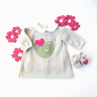 A knitted baby dress with felt hearts. 100% wool. Newborn.
