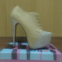 Sparkly blinged up patent nude shoe boots with very high stiletto heels.