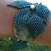 Beaded Bracelet - Asymmetrical Blue-Green Spray of Leaves, Shell, and Copper with Pearl Accent