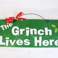 """The Grinch Lives Here"" Decor Sign With Glitter"