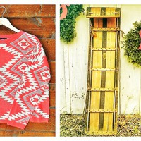 A Holiday story happens in this Tribal Time Sweater.