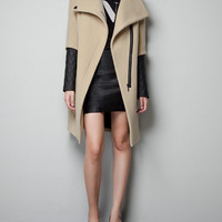 WOOLEN COAT WITH QUILTED SLEEVES - Coats - Woman - ZARA United States