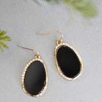 Crystal Fancy Pants Earrings - $16.00: From ourchoix.com, these black stone earrings are framed in gold and tiny crystals.