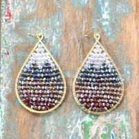 Cascading Winter Wonder Earrings - $52.00: From ourchoix.com, these beautiful wrapped gold oval frames have a cascade of crystals and beads.