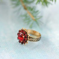 Ruby Radiance Ring - $24.00: From ourchoix.com, set in a slightly thicker gold hue this adjustable ring comes in sparkling ruby red crystals