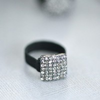 Smoke Fleck Ring - $14: From ourchoix.com, this glistening and glimmering square shaped ring is adorned in with a crystal and band of black.