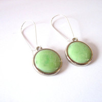 Resin earrings jewelry , mint green pale pistachio round silver discs silver wire hooks fixtures resin swirl ooak boutique design