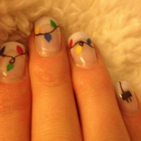 Finger Art!..what..Yeah I said FINGER ART! / Holiday fingernails. I love the plug on the pinky!