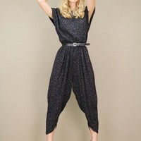 Black vintage jumpsuit with harem pants with a gold filigree print | shopcuffs.com