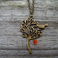 perched bird orange  antique brass necklace by MamasNestDesigns