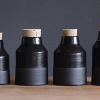 one tall black bottle. black stoneware pottery ceramic modern minimal simple