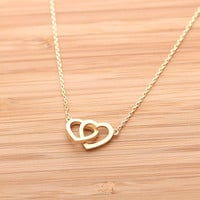 CROSSED OPEN HEART, never apart necklace in gold(plated, 925 sterling) | girlsluv.it