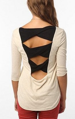 UrbanOutfitters.com > Tela Twist Back Bow Top in Ivory