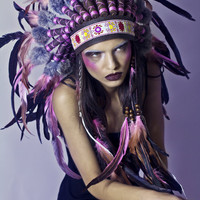 Salmon pink feather and leather headdress