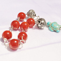 Southwestern  turquoise turtle charm bracelet with red glass beads