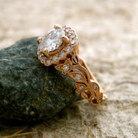 1.00 ct Forever Brilliant Round Moissanite Leaf Vine Engagement Ring in 14K Rose Gold in 4 Prong Setting with Diamonds and Antiquing