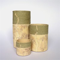 Set of green textured tea-light cylinders by Claire Lovett at Seek & Adore