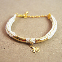 Lucky charm bracelet, four leaf clover charm, beige knit bracelet with gold bars