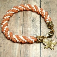 Sunset Orange and Cream Kumihimo 7 1/2 inch Spiral Bracelet
