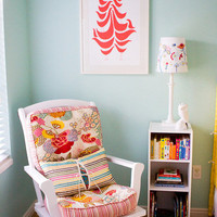 nurseries - Good Shape Design Flock Print white rocking chair pink turquoise blue cushions bookcase turquoise blue walls paint color nursery