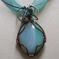 Green sardonyx wire wrapped pendant on ribbon by poshandplayful
