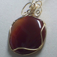 Large carnelian wire wrapped pendant by poshandplayful on Etsy