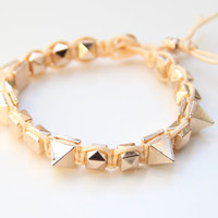 Arm candy - Gold Spikes beads and Peach cord - woven bracelet