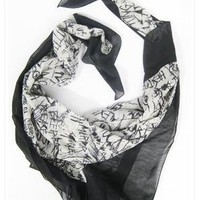 McQ Alexander McQueen Graffiti Scarf in Oat and Black at ShopGoldyn.com