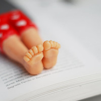 Real macho bookmark. Red pants with white hearts. Legs in the book. st. Valentine for her, him, for gay