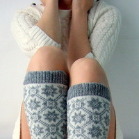 Knit leg warmers made of wool in gray and white color with traditional nordic ornament
