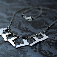 Six Guns sterling necklace with mini pistols by bLuGrnDesign