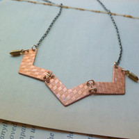 Copper chevron necklace on antiqued brass chain with bullet charms