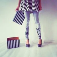 Black and white games-  grey leggings with graphic animal print