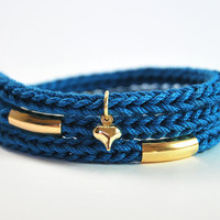 Blue wrap bracelet with gold tubes and heart charm. Gold bar bracelet, dark teal bracelet with charm