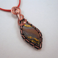 Tiger Iron Pendant Wire Wrapped in Copper on Red by UptightWanda