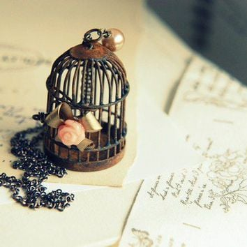 Dreams Kept. Whimsical bird cage and bow necklace. limited edition. only 5 left for sale