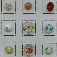 Vintage glass buttons with floral designs