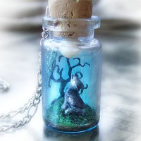 Wolf howling into the moon, clay scene bottle necklace